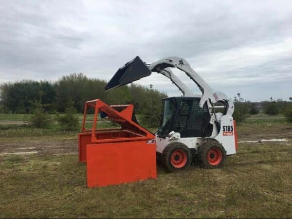 Topsoil being dumped through a screener